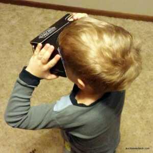 Nolan playing with Verizon's Star Wars Cardboard viewer